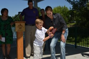 Childhood Cancer Survivors Trevor Schaefer and Konnor Johnson Cut the Ribbon at the Children's Cancer Pavilion June 6, 2015